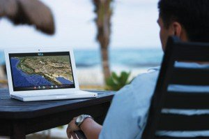 man_laptop_beach_hostedbrochure